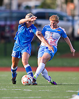 Chicago Red Stars midfielder/forward Lori Chalupny (17) tackles Boston Breakers defender Taryn Hemmings (25).  The Boston Breakers beat the Chicago Red Stars 1-0 at Dilboy Stadium.