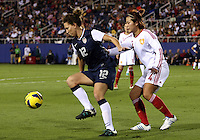 BOCA RATON, FL - DECEMBER 15, 2012: Lauren Cheney (12) of the USA WNT shields the ball from Li Jiayue (4) of China WNT during an international friendly match at FAU Stadium, in Boca Raton, Florida, on Saturday, December 15, 2012. USA won 4-1.
