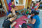 Mothers stimulate their children during a session of the early intervention program of Piña Palmera, a center for community based rehabilitation for people living with disabilities in Zipolite, a town in Oaxaca, Mexico.