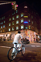 15 December 2006 - New York City, NY - A delivery man cycles by the 19th-century brick building at 11 Spring Street in the NoLIta neighborhood of New York City, USA, 15 December 2006, holding a three-day street art exhibition entitled Wooster on Spring. The building's new owners, Caroline Cummings and Bill Elias, called on the Wooster Collective to curate the show as a last hurrah for a site that long served as a canvas for street art.&amp;#xA;<br />