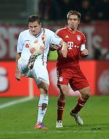 FUSSBALL  DFB-POKAL  ACHTELFINALE  SAISON 2012/2013    FC Augsburg - FC Bayern Muenchen        18.12.2012 Torsten Oehrl (li, FC Augsburg) gegen Philipp Lahm (FC Bayern Muenchen)