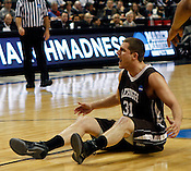 Justin Maeri reacts to a foul on Lehigh. Lehigh defeated Duke 75-70 during the 2nd round of the 2012 NCAA Basketball Championship at the Greensboro Coliseum in Greensboro, NC. Photo by Al Drago.