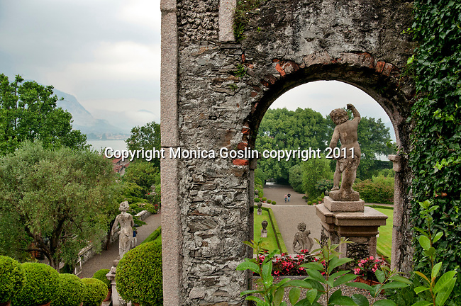 The terraced gardens and statues of the grand Palace on Isola Bella, an island in Lake Maggiore, Italy across from the town of Stresa