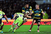 Courtney Lawes of Northampton Saints takes on the Sale Sharks defence. Aviva Premiership match, between Northampton Saints and Sale Sharks on December 23, 2016 at Franklin's Gardens in Northampton, England. Photo by: Patrick Khachfe / JMP