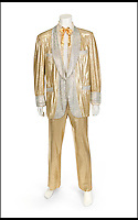 BNPS.co.uk (01202 558833)<br /> Pic: Julien's/BNPS<br /> <br /> ****Must use full byline****<br /> <br /> A shimmering gold suit that has been owned by Elvis Presley and Elton John has emerged for &pound;17,900.<br /> <br /> The eye-catching outfit was created by famous clothing designer Nudie Cohn for the King himself in the 1950s.<br /> <br /> The lame suit, which is embellished with silver rhinestones, would have cost around &pound;3,000.<br /> <br /> Elvis had more than one of the flashy costumes made and he is pictured on the front of his '50,000,000 Elvis Fans Can't Be Wrong' album wearing a similar version.<br /> <br /> Experts believe that Elton John met Elvis backstage after the show and that after expressing his admiration for the sparkling outfit, Elvis gave it to him.<br /> <br /> He sold the costume, which has been embroidered with a tag reading 'Elvis Presley', to a private collector who has now put it up for sale through Julien's Auctions in New York.