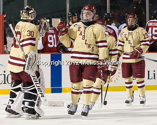 Chris Venti (BC - 30), Pat Mullane (BC - 11), Johnny Gaudreau (BC - 13) - The Boston College Eagles defeated the Northeastern University Huskies 2-1 on Saturday, January 14, 2012, at Fenway Park in Boston, Massachusetts.