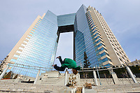 """Traceur (parkour practitioner) """"Zen"""" executes a flip. Practicing Parkour in Odaiba, Tokyo, Japan, January 27, 2012. Parkour is a modern method of physical training, also known as freerunning. It was founded in France in the 1990s. There is a small group of around 50 parkour practitioners in Tokyo."""