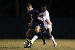 24 November 2013: Navy's Sam Bascom (left) and Wake Forest's Tolani Ibikunle (right). The Wake Forest University Demon Deacons played the Naval Academy Midshipmen at Spry Stadium in Winston-Salem, NC in a 2013 NCAA Division I Men's Soccer Tournament Second Round match. Wake Forest won the game 2-1.