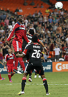 WASHINGTON, DC. - AUGUST 22, 2012:  Dwayne DeRosario (7) of DC United is beaten to a header by  Jalil Anibaba (6) of the Chicago Fire during an MLS match at RFK Stadium, in Washington DC,  on August 22. United won 4-2.