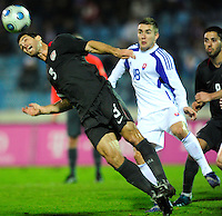 Carlos Bocanegra (3) heads the ball ahead of Jan Durica (18). Slovakia defeated the US Men's National Team 1-0 at the Tehelne Pole in Bratislava, Slovakia on November 14th, 2009.