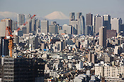 Mount Fuji and the Shinjuku district skyscraper skyline, Tokyo, Japan, Monday 3rd March 2009.