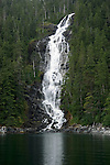 Alaska, Cruising the Southeast wilderness waterways on the Spirit of Discovery..Kasnyku Falls in Waterfall Cove..Photo copyright Lee Foster, 510/549-2202, lee@fostertravel.com, www.fostertravel.com.