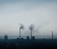 A factory emits carbon dioxide into the atmosphere as it burns coal in Shanxi Province.