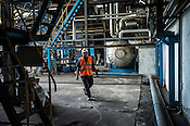 A factory worker seen at the Sipef oil mill in Sumatra, Indonesia.