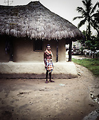 A villager poses outside his hut in Dinghia village in Orissa, India. His hut is the closest to the entry gate of the village. Temporary fences have been erected by them around the boundary of the village to prevent the entry of survey team into their area. South Korean steel giant POSCO continues to face stiff public resistance in Orissa's Jagatsinghpur district where the company is setting up India's biggest direct foreign investment project of 12 million tonne steel plant. These villagers have formed an agitating group, &quot;Posco Pratirdh Sangram Samiti&quot; to oppose the construction of Posco port in their village.