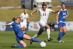 04 November 2009: Florida State's Amanda DaCosta (13) jumps over a tackle by Duke's Jane Alukonis (left). The Florida State University Seminoles defeated the Duke University Blue Devils 2-0 at Koka Booth Stadium in WakeMed Soccer Park in Cary, North Carolina in an Atlantic Coast Conference Women's Soccer Tournament Quarterfinal game.