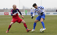 Mauro Zarate of QPR and Eric Gehrig of Chicago Fire