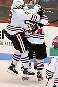 Adam Reid (NU - 8), Kevin Roy (NU - 15), Vinny Saponari (NU - 74) - The Northeastern University Huskies defeated the visiting Merrimack College Warriors 4-2 (EN) on Wednesday, October 10, 2012, at Matthews Arena in Boston, Massachusetts.