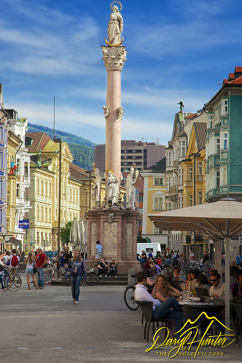 Sidewalk cafe in the square of Old Town,  Innsbruck Austria, Our Lady Statue towering over the square. I love the old style European architecture of Innsbuck.