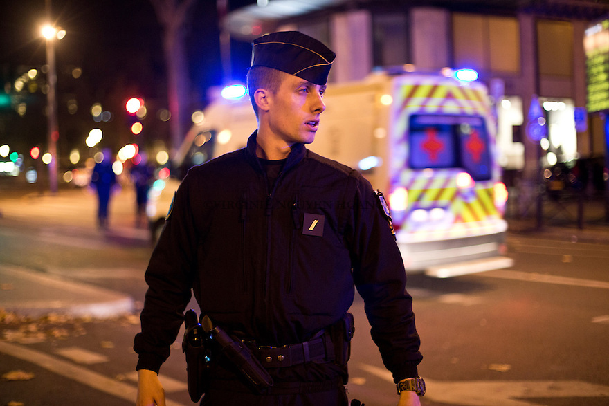 FRANCE, Paris: A police officer is blocking the access to the Place Republic in Paris on the 13th November 2015. Shootings and blasts leave at least 120 dead in Paris