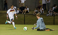 Winthrop University Eagles vs the Brevard College Tornados at Eagle's Field in Rock Hill, SC.  The Eagles beat the Tornados 6-0.  C.J. Miller (5) is to late to the ball as Heath Turner (0) goes for the save.