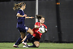 29 September 2011: Duke's Tara Campbell (1) grabs the ball in front of Virginia's Caroline Miller (10). The Duke University Blue Devils and the University of Virginia Cavaliers played to a 0-0 tie after overtime at Koskinen Stadium in Durham, North Carolina in an NCAA Division I Women's Soccer game.