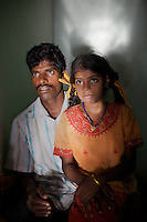 Viswanathan with his daughter Vijyashree at home in the fishing village of Thazanguda, near Cuddalore. ..Vijita (age 14) and Vijyashree (age 11) Viswanathan lost their mother and brother to the tsunami in 2004. They continue to live in the fishing village of Thazanguda with their father Viswanathan, his second wife Kayalvizhi and their two children Sanjay (age 3) and Monica (age 1). ..Until the beginning of the 2009 academic year in June, Vijita and Vijyashree attended the local Thazanguda school. This village school teaches pupils only until the 8th Standard and with Vijita now entering the 9th, it was decided that the two daughters remain together and both travel 3km to the local town school: the Government Girls High School, Venugopalapuram in Cuddalore. ..At the same time Viswanathan decided he would cease day-to-day care of his daughters and place them in the Government Home for Tsunami Children, also in Cuddalore. This was not a move welcomed by either Vijita or Vijyashree and one afternoon after just two weeks at the orphanage, the two girls ran away. At roll call in the orphanage that evening the alarm was sounded and the two sisters were eventually located in Thazanguda waiting for their father and Kayalvizhi who were both away at the time. Realising his daughters' unhappiness, Viswanathan then took them out of the Government home. ..According to her class teacher, Vijita often compares her step-mother to her mother and concludes that she wants her mother back. Vijita confides in her teachers that her stepmother is forever demanding that she and her sister Vijyashree undertake housework. This frustration at home is tempered by the genuine love both sisters have for their father and two younger siblings Sanjay and Monica. Vijita expresses a lonelyness without her mother. Pushpavalli concludes that &quot;Vijita wants something else beyond the love of her father and sister&quot;. ..Viswanathan appears genuinely to want the best for his two elder daughters. His experimen