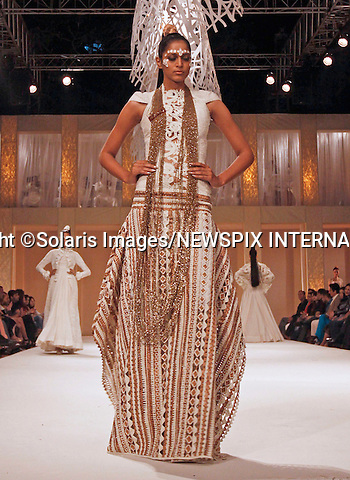 """Mumbai, India-06/03/2012: LAKME FASHION WEEK.Creation from designer Rohit Bal at the LFW Summer/Resort 2012 fashion collection, during Lakme Fashion Week 2012 in Mumbai, India..Mandatory Photo Credit: ©Srinivas Akella-Solaris Images/NEWSPIX INTERNATIONAL..**ALL FEES PAYABLE TO: """"NEWSPIX INTERNATIONAL""""**..PHOTO CREDIT MANDATORY!!: NEWSPIX INTERNATIONAL(Failure to credit will incur a surcharge of 100% of reproduction fees)..IMMEDIATE CONFIRMATION OF USAGE REQUIRED:.Newspix International, 31 Chinnery Hill, Bishop's Stortford, ENGLAND CM23 3PS.Tel:+441279 324672  ; Fax: +441279656877.Mobile:  0777568 1153.e-mail: info@newspixinternational.co.uk"""