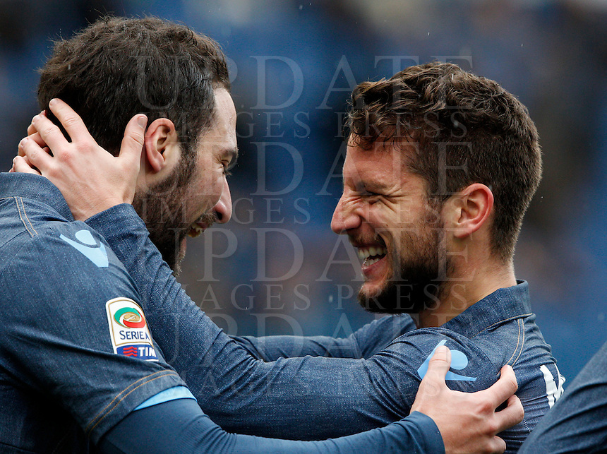 Calcio, Serie A: Lazio vs Napoli. Roma, stadio Olimpico, 18 gennaio 2015.<br /> Napoli&rsquo;s Gonzalo Higuain celebrates with teammate Dries Mertens, right, after scoring during the Italian Serie A football match between Lazio and Napoli at Rome's Olympic stadium, 18 January 2015.<br /> UPDATE IMAGES PRESS/Riccardo De Luca