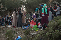 The refugee camp contains thousands of people mostly from Afghanistan. There are just two water pipes and no electrictity or sanitation. The registration centre which enables refugees to travel on to Athens has a back log of several days with refugees queuing around the clock.