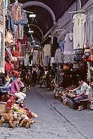 Tunisia.  Tunis Medina.  Souk.  Clothing, Purses.