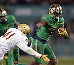 (Boston, MA, 11/21/15) Notre Dame's Chris Brown, right, carries the ball past Boston College's William Harris during the third quarter as Notre Dame hosts Boston College at Fenway Park in Boston on Saturday, November 21, 2015. Photo by Christopher Evans