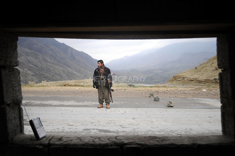 QANDIL, IRAQ:  A PKK guerrilla mans a checkpoint in the Qandil mountains...The Kurdistan Workers' Party (PKK) is a pro-Kurdish party in Turkey deemed a terrorist group by the USA and the EU.  They are based in the Qandil mountains that make up the border between Iraq and Turkey...Photo by Kamaran Najm/Metrography