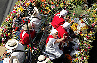 "MEDELLIN, COL AUG 07. Flower growers known as ""silleteros""  near floral arrangements  of an  flower 59th in Medellin,  Colombia, on August 7, 2016. (Photo by Fredy Builes / VIEWpress)"