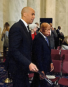 United States Senator Cory Booker (Democrat of New Jersey), left, and US Representative John Lewis (Democrat of Georgia) arrive to appear on a panel testifying before the United States Senate Judiciary Committee on the nomination of US Senator Jeff Sessions (Republican of Alabama) to be Attorney General of the United States on Capitol Hill in Washington, DC on Wednesday, January 11, 2017.  Senator Booker became the first sitting senator in US history to testify against a fellow sitting senator at a cabinet confirmation hearing.<br /> Credit: Ron Sachs / CNP