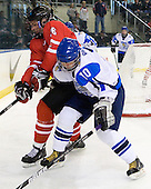 Taylor Doherty (Canada - 26), Iiro Pakarinen (Finland - 10) - Finland defeated Canada 5-4 (so) in the 2009 World Under 18 Championship bronze medal game at the Urban Plains Center in Fargo, North Dakota, on Sunday, April 19, 2009.