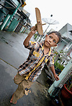 Five-year old Mohibuddin runs with his toy wooden airplane along a sidewalk in Kuala Bubon, in Indonesia's Aceh province. The community of 118 houses was built by the ACT Alliance after the village's tsunami survivors refused to accept government plans to relocate them inland far from the sea. After the houses were built, the community then successfully fought a government plan to demolish part of the new village to make way for a new highway.<br /> <br /> Parental consent obtained.