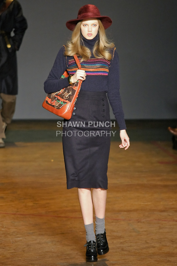 Lindsey Wixson walks runway in a bright navy bonded nylon wool coat, gettysburg blue multi hunter plaid shirt, canteen crispy cotton nylon pant, navy panther print messenger bag, and brown snakeskin hi-tops, from the Marc by Marc Jacobs Fall/Winter 2011 collection, during New York Fashion Week, Fall 2011.