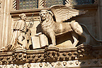 Sculpture of a Doge and the Lion of Venice above a door of Doges Palace - Venice Italy