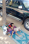 Kids Sleeping On Sidewalk