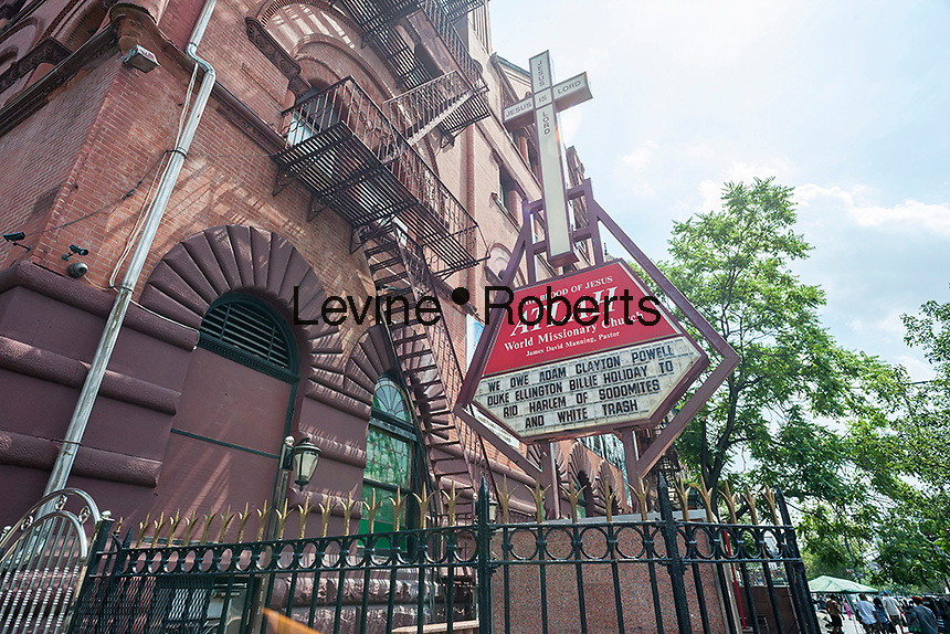 The ATLAH World Missionary Church on Lenox Avenue in Harlem in New York is seen on Saturday, July 16, 2016.  The pastor of the church, James David Manning, uses the sign to show his displeasure with gays, in this case by posting a homophobic message about white homosexuals gentrifying Harlem. (© Richard B. Levine)