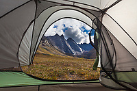 East and West Maiden and Camel peaks in the distance, viewed from inside a tent, Arrigetch Peaks, Gates of the Arctic National Park, Alaska.