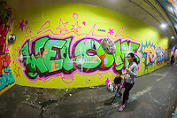 A  portion of  the 900-foot long 191st Subway station connecting tunnel, painted by COPE2, and newly decorated by artists hired by the New York City Dept. of Transportation on Thursday, May 21, 2015. The artists, COPE2, Queen Andrea, Nick Kuszyk, Cekis and Jessie Unterhalter and Katey Truhn were chosen in a competitive process by the DOT. The tunnel has recently received upgraded LED lighting and with the addition of the murals has been turned into an art gallery. (© Richard B. Levine)