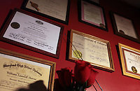 Pastor William Horne's Certificates of Consecration on the wall of his home in Baltimore, MD on August 8, 2010. .William Horne lost his home in a rent-back scheme and is currently suing the company. For ProPublica on the Baltimore foreclosure story. .Photographer: Melanie Burford for ProPublica.