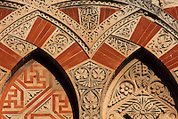 Architectural detail of the Puerta de San Ildefonso, built under Al-Hakam II in the 10th century, one of the West facade entrances to the Cathedral-Great Mosque of Cordoba, on the Calle Torrijos in Cordoba, Andalusia, Southern Spain. This detail shows the intricately carved vegetal patterns and red brick on an overlapping arch design. The first church built here by the Visigoths in the 7th century was split in half by the Moors, becoming half church, half mosque. In 784, the Great Mosque of Cordoba was begun in its place and developed over 200 years, but in 1236 it was converted into a catholic church, with a Renaissance cathedral nave built in the 16th century. The historic centre of Cordoba is listed as a UNESCO World Heritage Site. Picture by Manuel Cohen