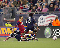 New England Revolution defender Pat Phelan (28) slide tackles Real Salt Lake midfielder Will Johnson (8) and New England Revolution defender Emmanuel Osei (5) prepares to pick up the loose ball. Real Salt Lake defeated the New England Revolution, 2-1, at Gillette Stadium on October 2, 2010.