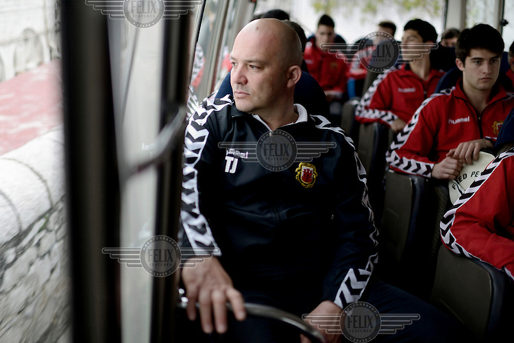 Players and the coach of the Gibraltarian under-17 national team on a bus prior to a match against Northern Ireland played in March 2013. Although the United Nations doesn't recognise Gibraltar as an independent country, UEFA has recognised it and has granted the British Overseas Territory full UEFA membership.