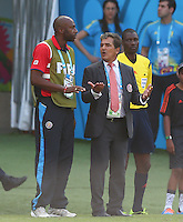 Costa Rica assistant manager Paulo Wanchope talks to manager Jorge Luis Pinto