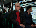 Men in a bus with a red jumper and a red shirt on the day following Hollande victory. France heads to its new future.