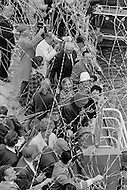 07 May 1969. Passengers aboard the Queen Elizabeth II cruise liner wave and throw streamers at the west pier in New York Harbor during the liner's maiden voyage from Southampton, England to New York City.